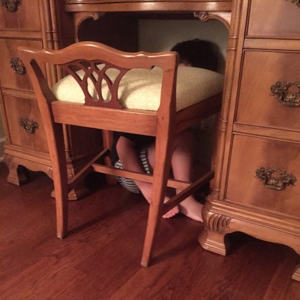 hiding boy.jpg